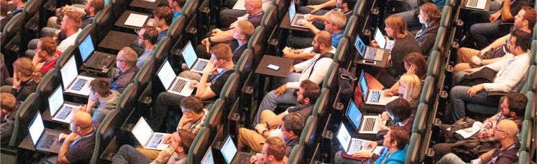 Delegates on Laptops at DrupalCon